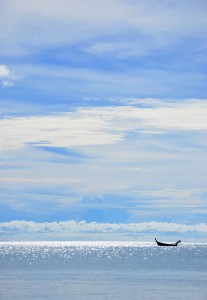 boat on the water with blue skies