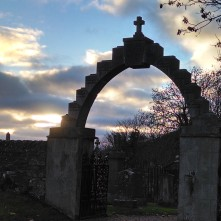 Suset over Scottish cemetery entrance