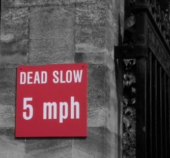 dead slow road sign