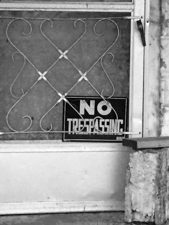 Black and white, No Trespassing Sign in doorway