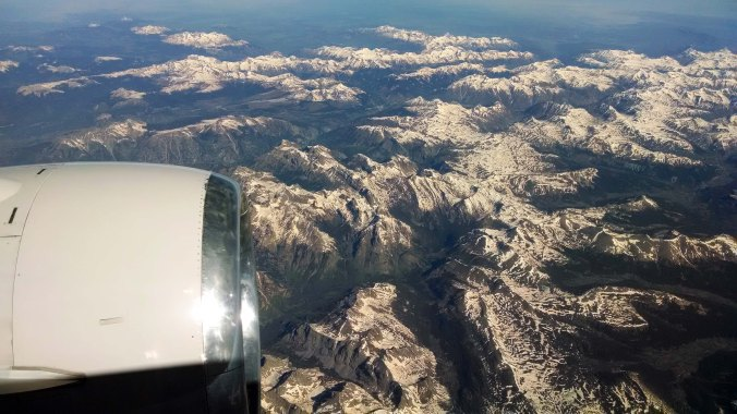 Rocky Mountains covered in snow from airplane