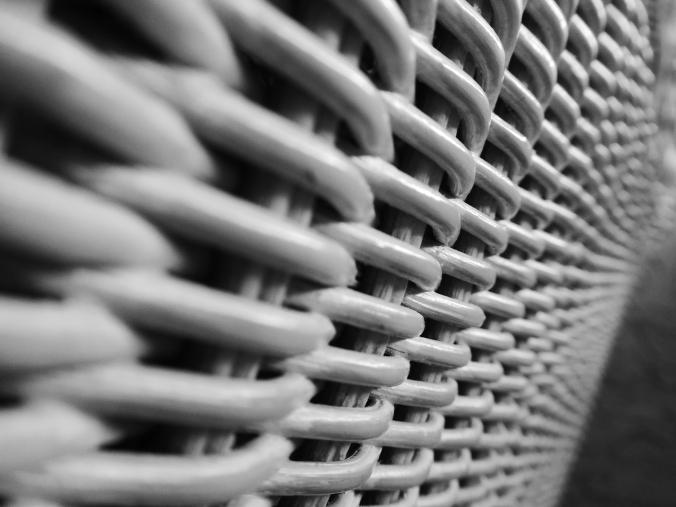 black ad white wicker chair