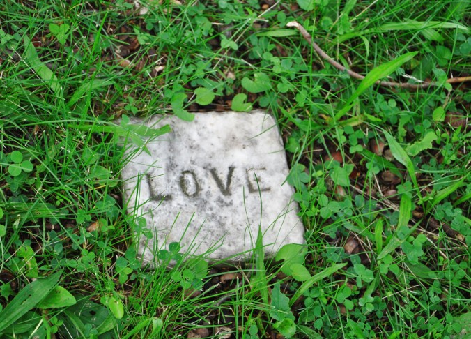love stone in green grass