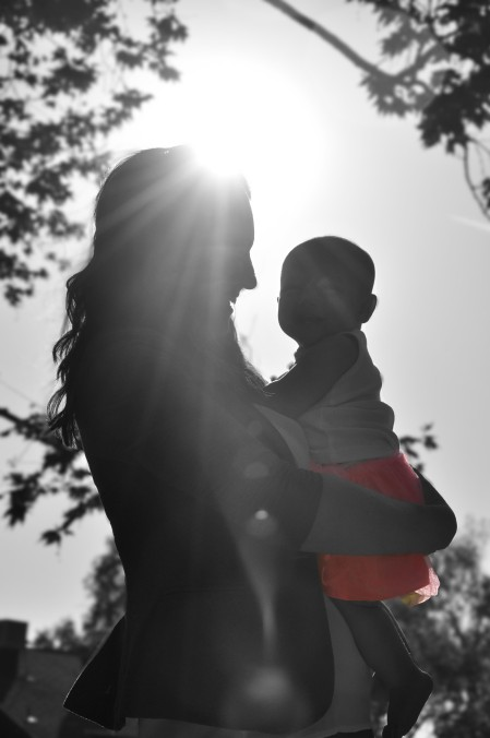 woman with baby in black and white