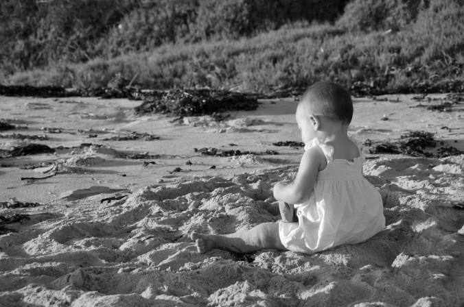 Baby on beach, black and white