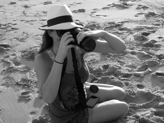 girl on beach with camera, black and white