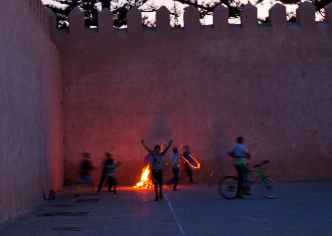street kids with fire in Essaouira Morocco