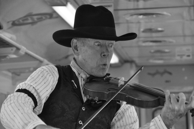 man playing fiddle, black and white