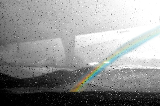 Rainbow through bus window, Iceland